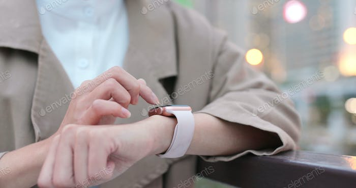 Woman use of smart watch at outdoor