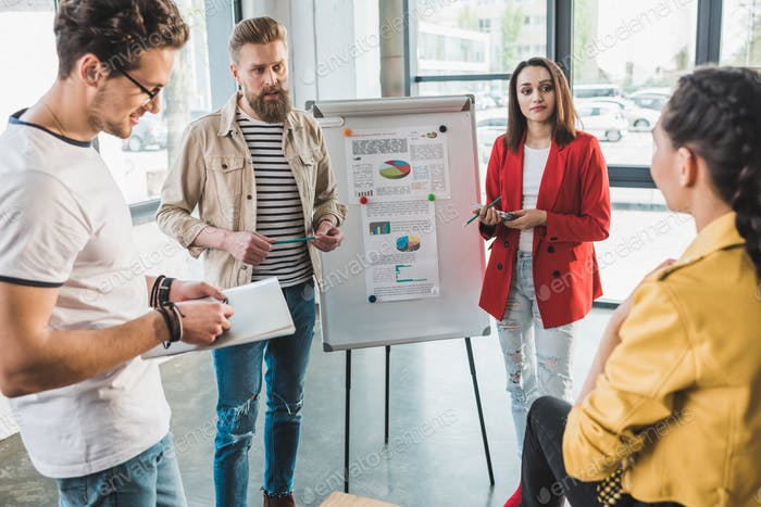 Diverse business team creating presentation in light workspace