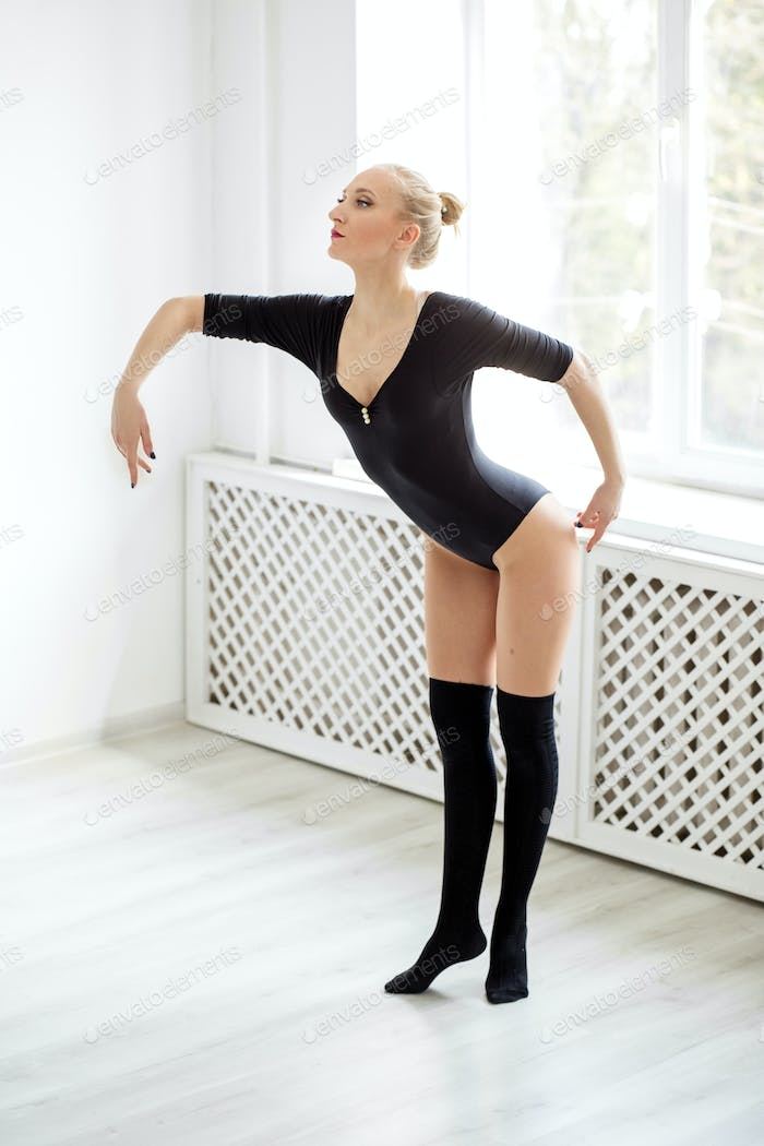 Graceful woman dancer dancing classics. Concept of sport, dance and healthy lifestyle.