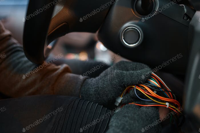Professional car thief hacking ignition lock