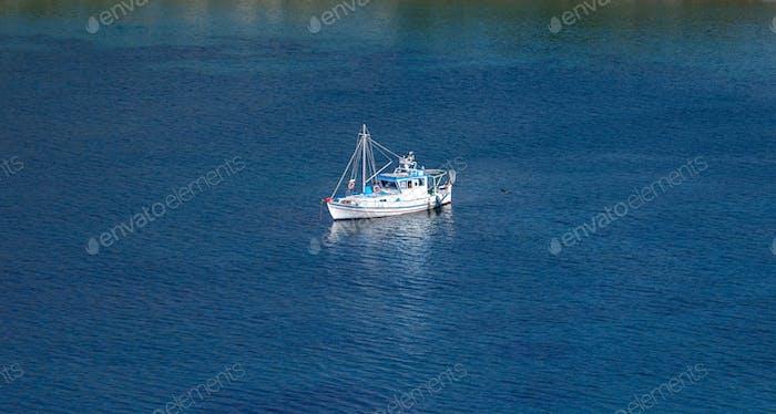 Kea, Tzia, Greece. Traditional fishing boat, trawler moored at Otzias cove.