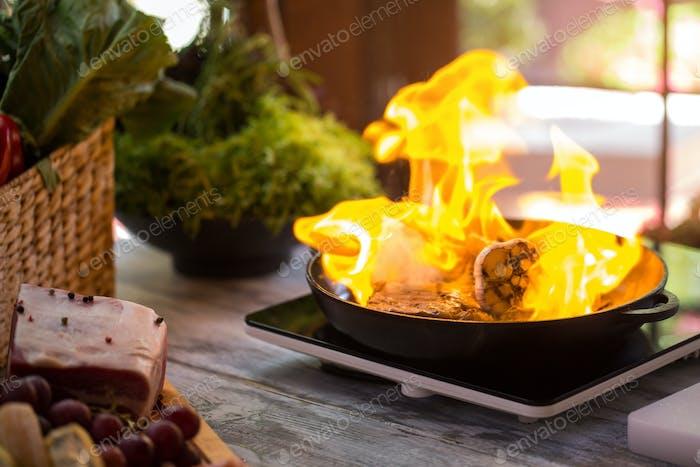 Flame in black pan