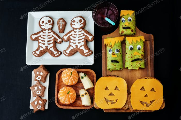 childrens with lunch in the form of monsters
