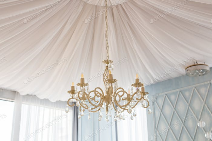 Close-up of a beautiful white crystal chandelier