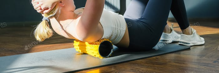 Myofascial release massage Fitness, fit, Girl engaged in stretching fascia by fitness gym.