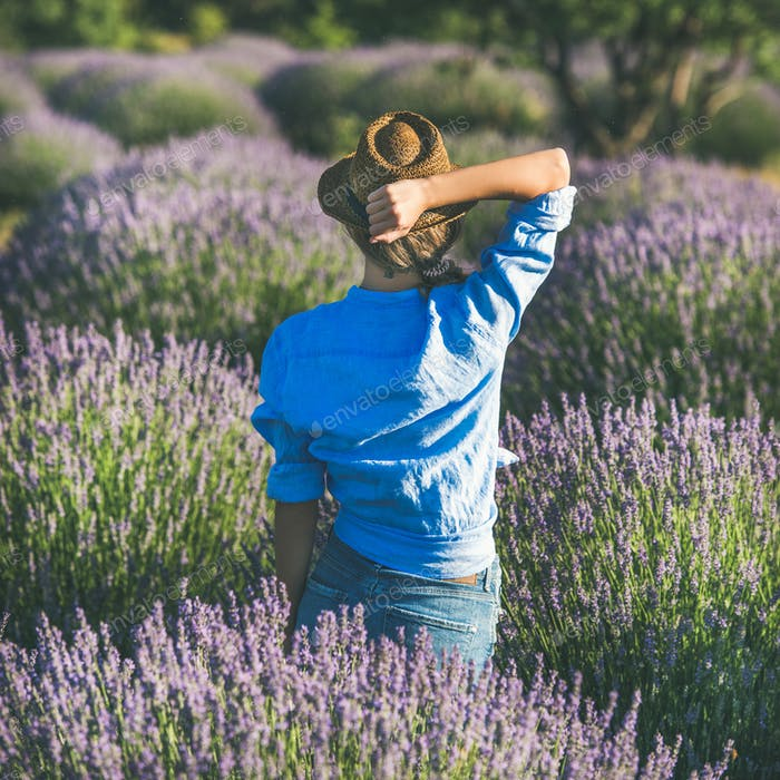 Young woman in straw hat enjoying lavender field, square crop