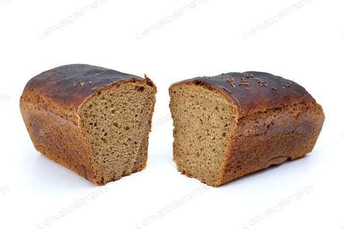 Two chunks of rye bread with anise
