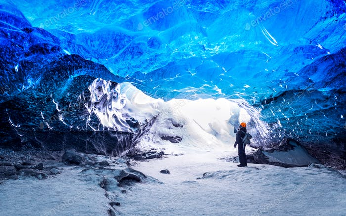 Traveler in ice cave