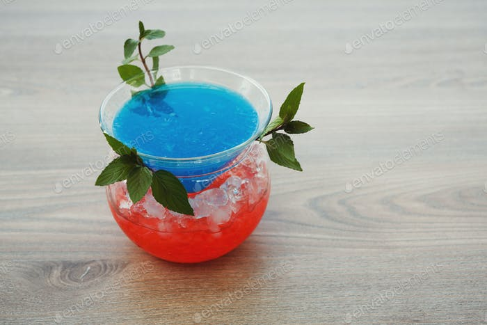 Blue hawaii cocktail served on restaurant table