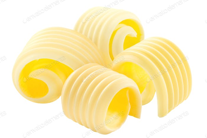 Butter curls rolled up, a group of four,  isolated