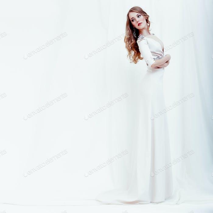 fashion portrait of a sensual girl in a white dress