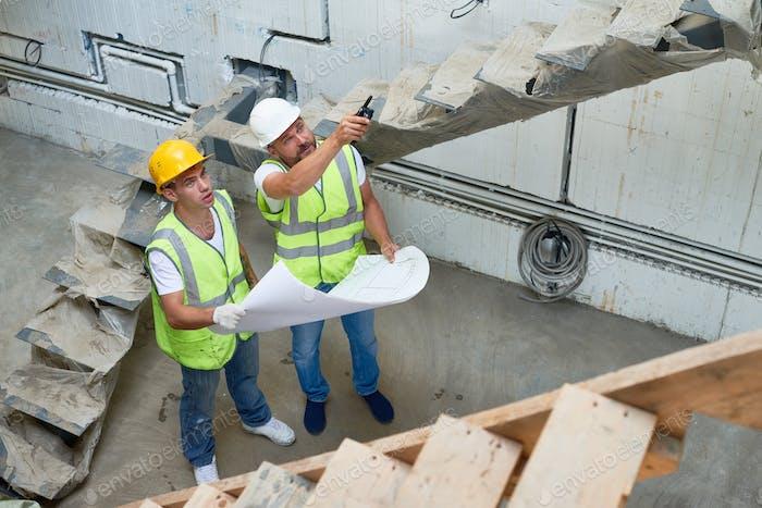 Construction Supervisor Discussing Building Plans