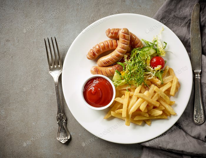Plate of fried potatoes and sausages