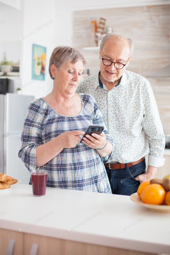 Retired couple browsing on smartphone
