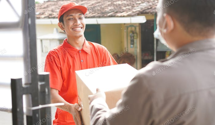 delivery man delivers the box to the customer
