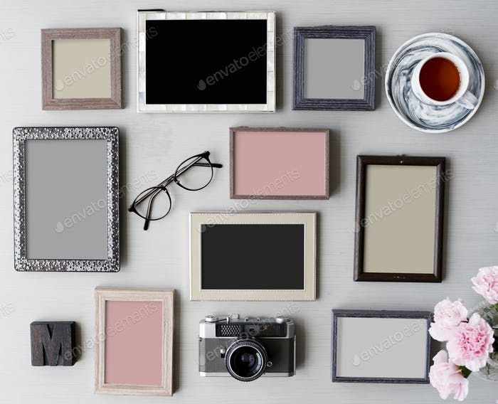 Set of Blank Photo Frames on Gray Table