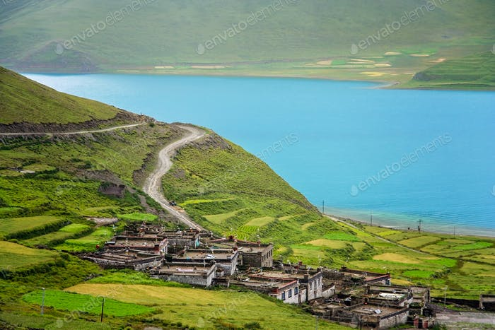 Traditional tibetan homes above Yamdrok Tso Lake lake