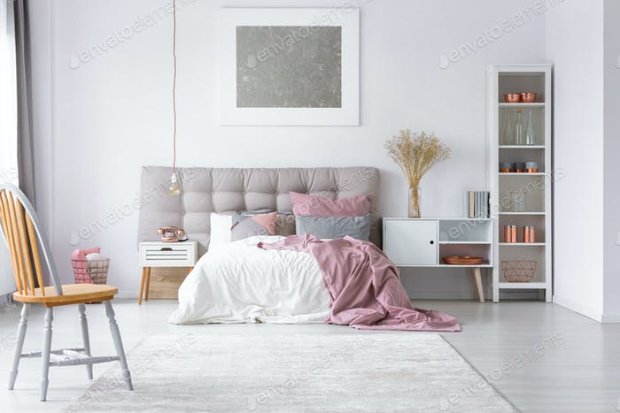 Mockup silver painting on white wall of cute bedroom interior