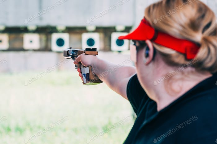 Woman on sport shooting training shooting target
