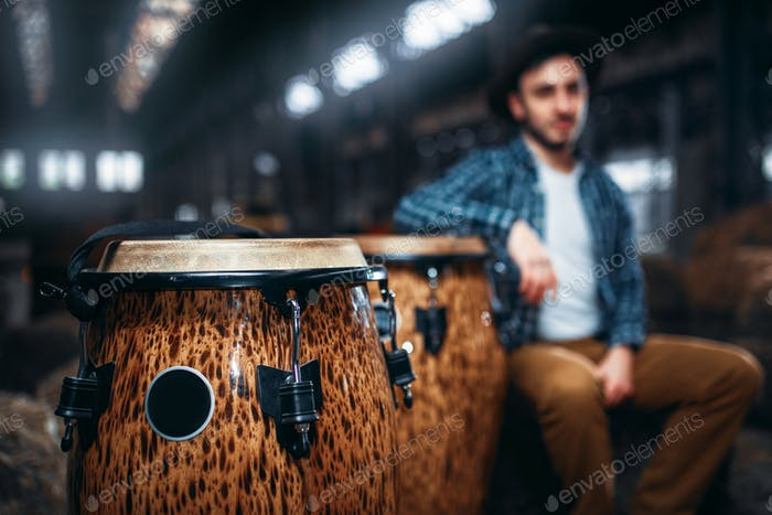 Wooden drums, closeup, male drummer on background