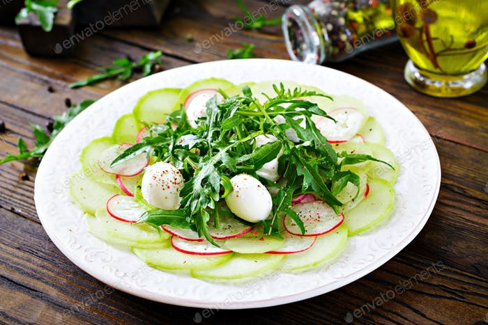Carpaccio of radish with arugula, mozzarella and  sauce. Healthy food. Daikon salad