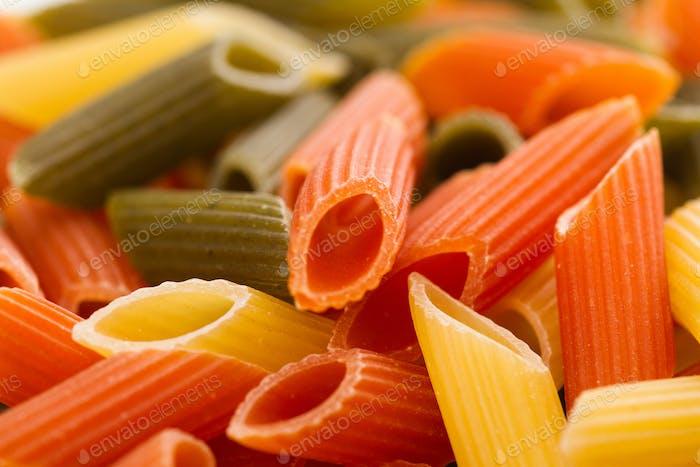 macro detail of three colored wheat pasta