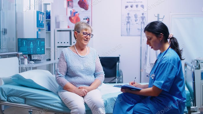 Discussion with nurse in modern hospital