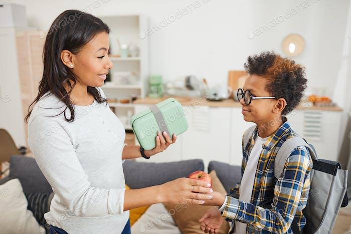 Mother Sending Son to School