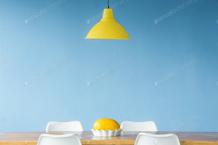Yellow lamp over table