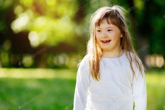 Beutiful happy child smiling outdoors