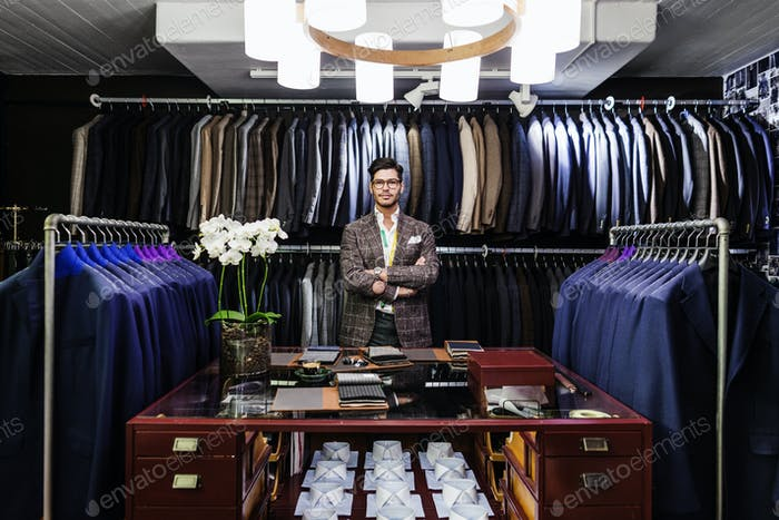 Man standing in clothing store