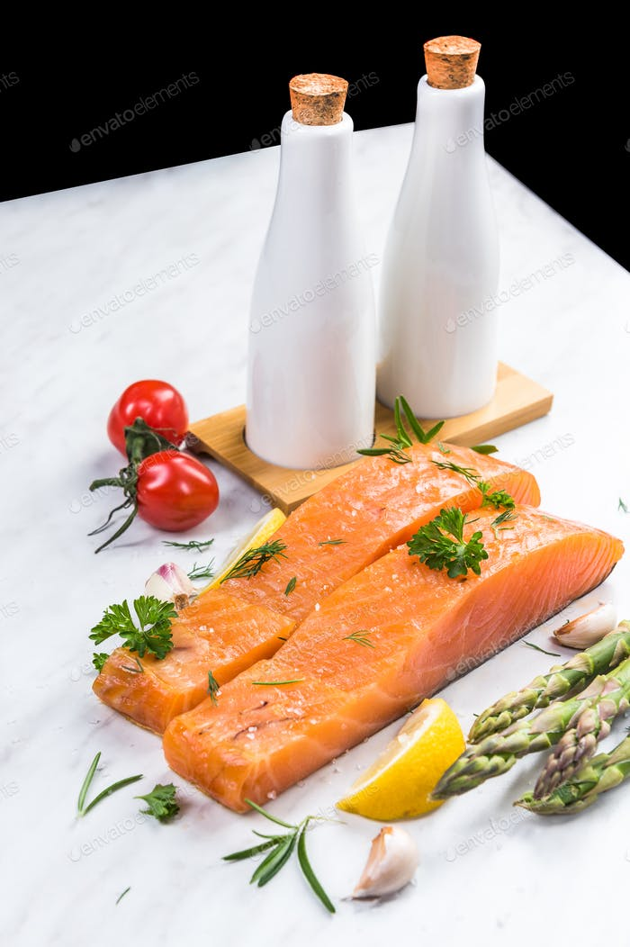 Cold smoked salmon fish fillets with lemon,spices and herbs