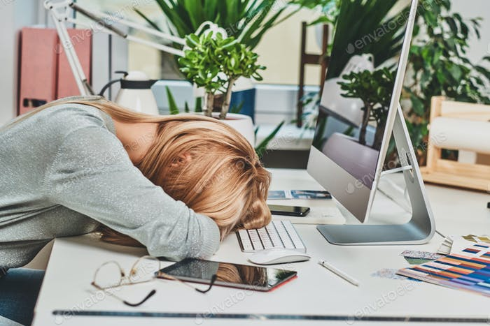 Woman is tired while working in office