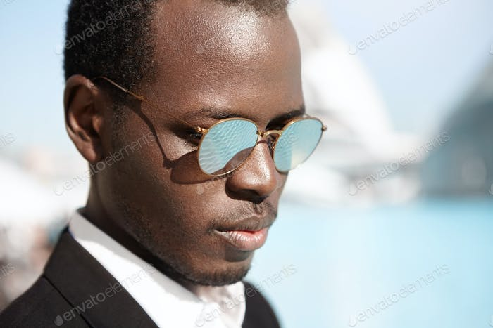 People, style, fashion and business concept. Headshot of attractive fashionable young African Americ