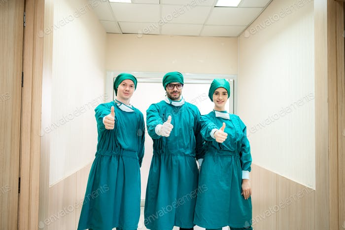 Group of doctors wearing surgical gown after success surgery