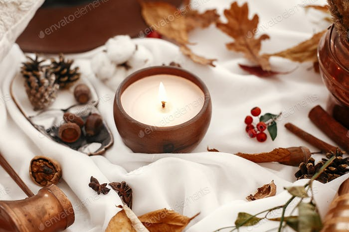 and brown hat on white fabric. Autumn mood. Hello autumn, cozy inspirational image.