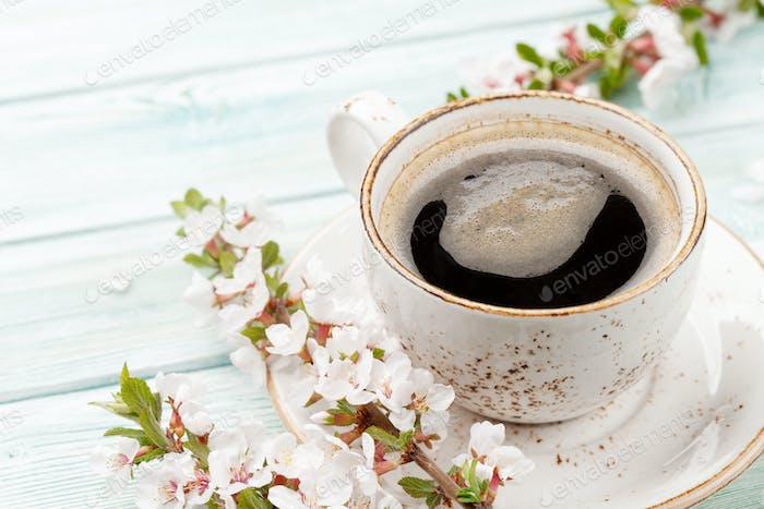 Morning espresso coffee cup and cherry blossom