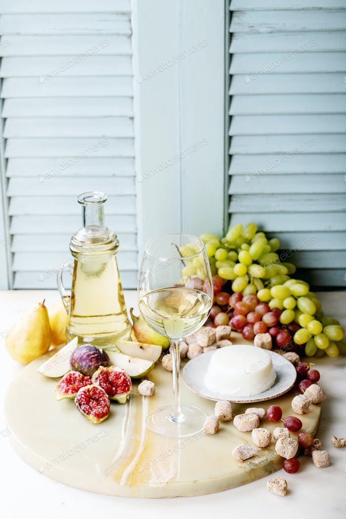 White wine in a glass served with fresh fruits