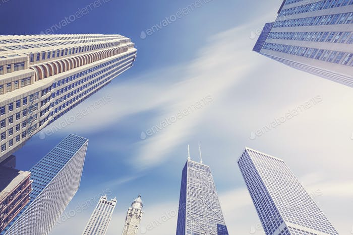 Color toned photo of Chicago skyscrapers with motion blurred clo