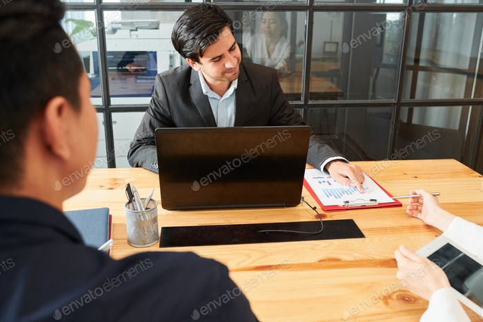 Male leader holding a meeting