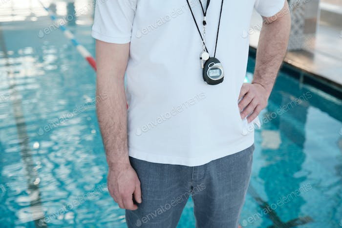 Coach with stopwatch and whistle