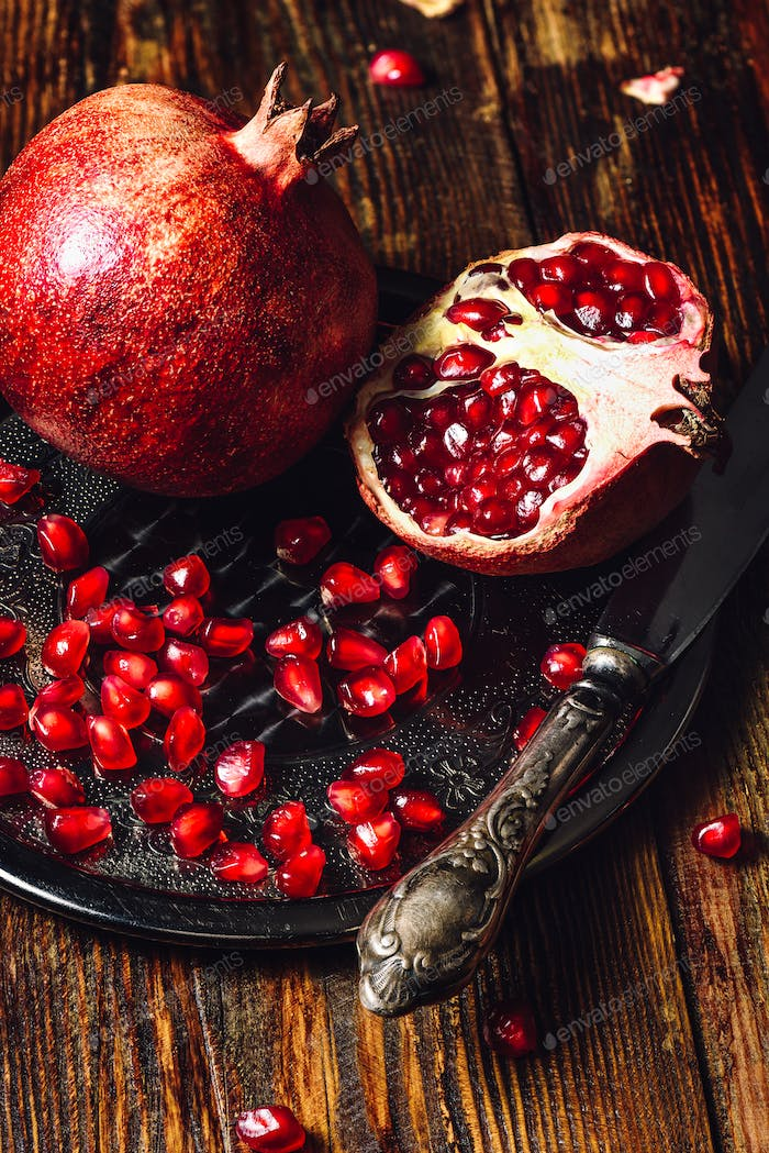 Pomegranates with Seeds and Knife