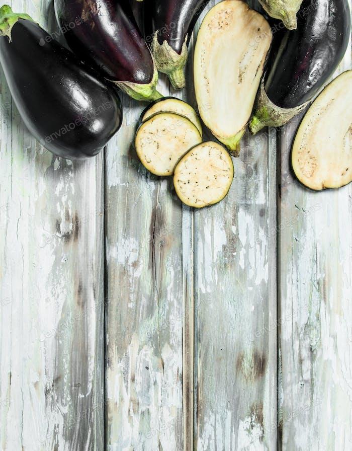 Whole eggplants and slice of eggplant.