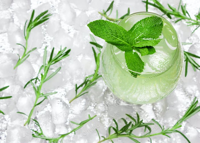 Cold mojito, refreshing lemonade with mint leaves and ice cubes