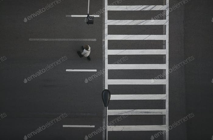 High angle view of pedestrian crossing street