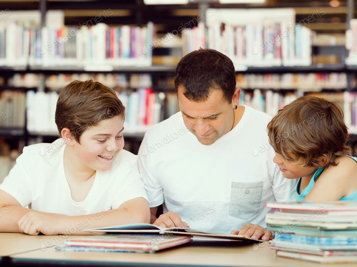 Father with sons in library