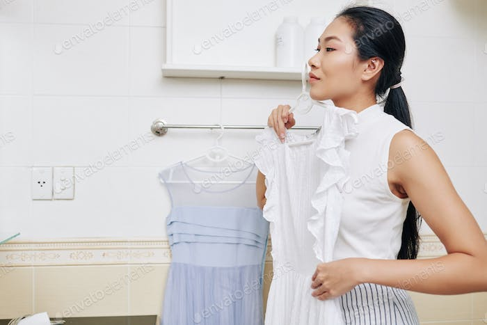 Young woman choosing outfit
