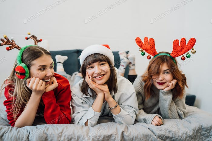 Gorgeous Smiling Female Models Having Fun And Enjoying Pajamas Party