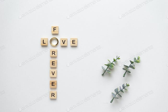 Wooden letters and wedding ring speling love for ever, with oreg