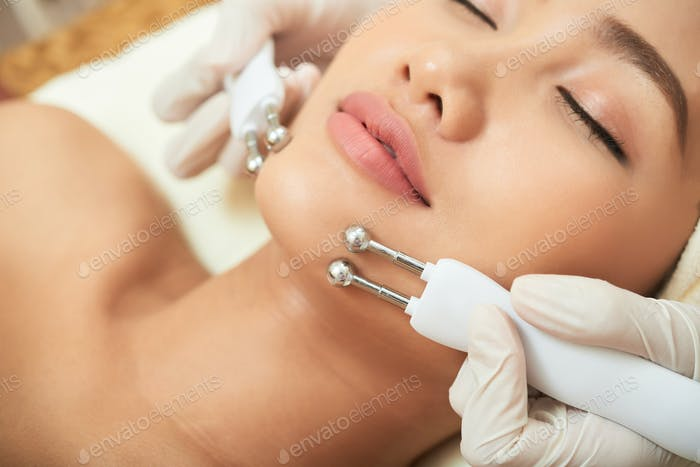 Receiving Galvanic Beauty Treatment